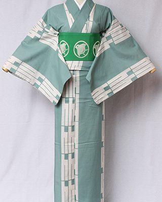 古典文様を反物巾一杯に配し、大胆でモダンにしたシリーズ。源氏香とは香道から生まれた古典文様。「源氏物語」の帖の名がある。絽素材使用。